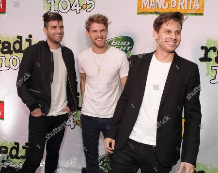 Cubbie Fink, from left, Mark Pontius and Mark Foster of the band Foster the People perform in concert during the Radio 104.5 7th Birthday Show at the Susquehanna Bank Center, in Camden, N.J