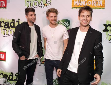 Cubbie Fink, from left, Mark Pontius and Mark Foster of the band Foster the People pose for photographers backstage during the Radio 104.5 Birthday Show at the Susquehanna Bank Center, in Camden, N.J