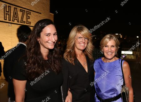 From left, Bettina Korek, Madeline Weeks and Iris Marden pose during the reception for the inaugural exhibition at Regen Projects' new Hollywood gallery, in Los Angeles, Calif