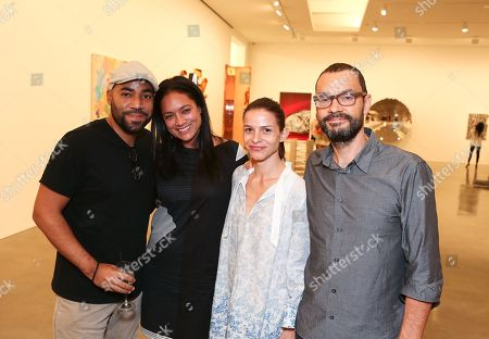 Stock Image of From left, Jeremy Rall, Jennifer Arceneaux, Ana Provacki and Sam Durant pose during the reception for the inaugural exhibition at Regen Projects' new Hollywood gallery, in Los Angeles, Calif