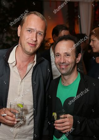 Stock Photo of From left, artists Christian Jankowski and Gabriel Kuri pose during the reception for the inaugural exhibition at Regen Projects' new Hollywood gallery, in Los Angeles, Calif