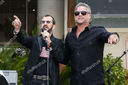 Ringo Starr, left, and Jon Stevens perform at Starr's 76th birthday celebration at Capitol Records, in Los Angeles