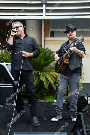 Jon Stevens, left, and Dave A. Stewart perform at Ringo Starr's 76th birthday celebration held at Capitol Records, in Los Angeles