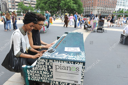 Jay Williams and Lee Bullitt, of New York, play on the piano designed by Arianna Huffington and her sister Agapi Stassinopoulos, one of the 88 Sing for Hope Pianos, supported by Chobani, Inc., at the Josie Robertson Plaza at Lincoln Center, . Â The event celebrates the conclusion of the Sing for Hope Pianos project, a two-week public art installation around the five boroughs of New York. Â