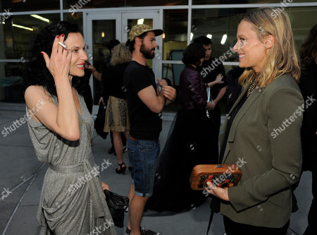 "Xan Cassavetes, left, writer/director of ""Kiss of the Damned,"" mingles with actress Vinessa Shaw at a Los Angeles screening of the film at the ArcLight Hollywood on in Los Angeles"