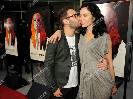 "Xan Cassavetes, writer/director of ""Kiss of the Damned,"" gets a kiss from writer/director John Krokidas at the Los Angeles screening of the film at the ArcLight Hollywood on in Los Angeles"