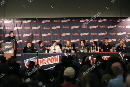 "From left, moderator Jim Halterman, Jon Steinberg, Robert Levine, Dan Shotz, Hannah New, Luke Arnold, Jessica Parker Kennedy, Tom Hopper, and Clara Paget are seen onstage during the panel for the STARZ Original Series ""Black Sails"" at New York Comic Con on in New York"