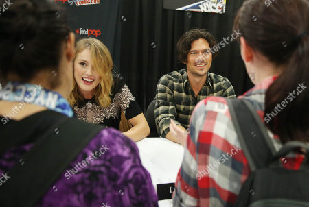 "Hannah New, left, and Luke Arnold, from the STARZ Original Series ""Black Sails"", are seen during an autograph signing at New York Comic Con on in New York"
