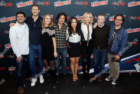 "From left, Dan Shotz, Tom Hopper, Hannah New, Luke Arnold, Jessica Parker Kennedy, Clara Paget, Jon Steinberg, and Robert Levine, from the STARZ Original Series ""Black Sails"", pose for a photo at New York Comic Con on in New York"