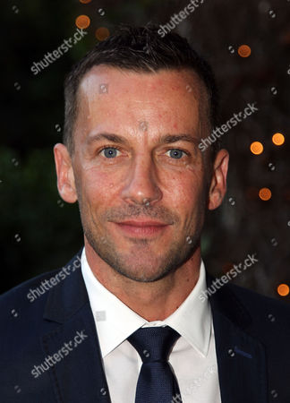 """Craig Parker poses for a photo at STARZ' """"The White Queen"""" cocktail event at the British Consulate on in Los Angeles. """"The White Queen"""" premieres Saturday, Aug. 10 on STARZ"""