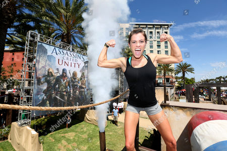 Kacy Catanzaro celebrates the completion of the parkour course at Ubisoft's Assassin's Creed Experience during Comic-Con on Thurs., in San Diego. The Assassin's Creed Experience is open to the public through Sun. July 27th