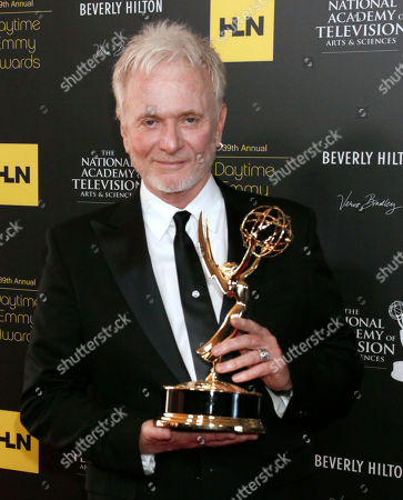 "Anthony Geary poses backstage with the award for lead actor in a drama series for ""General Hospital"" at the 39th Annual Daytime Emmy Awards at the Beverly Hilton Hotel on in Beverly Hills, Calif"