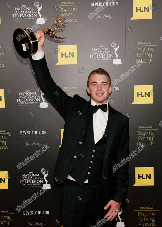 """Chandler Massey poses backstage with the award for outstanding younger actor in a drama series for """"Days of our Lives"""" at the 39th Annual Daytime Emmy Awards on HLN at the Beverly Hilton Hotel on in Beverly Hills, Calif"""