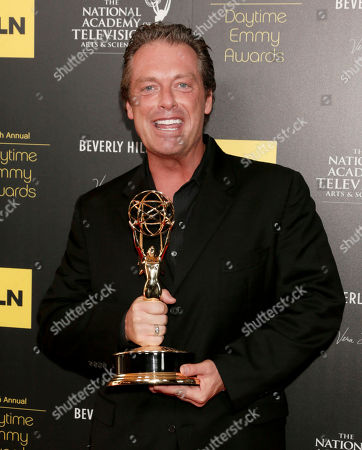 "Todd Newton poses backstage with the game show host award for ""Family Game Night"" at the 39th Annual Daytime Emmy Awards on HLN at the Beverly Hilton Hotel on in Beverly Hills, Calif"
