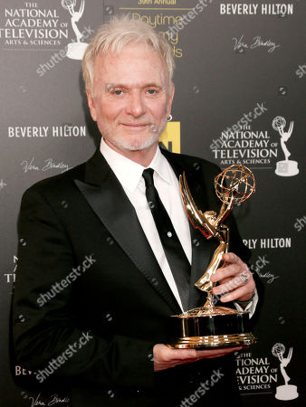 "Anthony Geary poses backstage with the award for lead actor in a drama series for ""General Hospital"" at the 39th Annual Daytime Emmy Awards on HLN at the Beverly Hilton Hotel on in Beverly Hills, Calif"