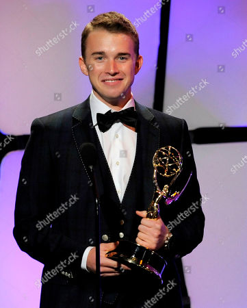 """Chandler Massey accepts the award for outstanding younger actor for """"Days of our Lives"""" onstage at the 39th Annual Daytime Emmy Awards at the Beverly Hilton Hotel on in Beverly Hills, Calif"""
