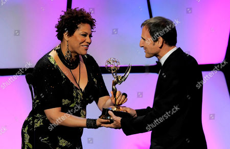 """Kim Coles, left, presents the talk show - entertainment award to Michael Gelman for """"Live with Regis and Kelly"""" onstage at the 39th Annual Daytime Emmy Awards at the Beverly Hilton Hotel on in Beverly Hills, Calif"""
