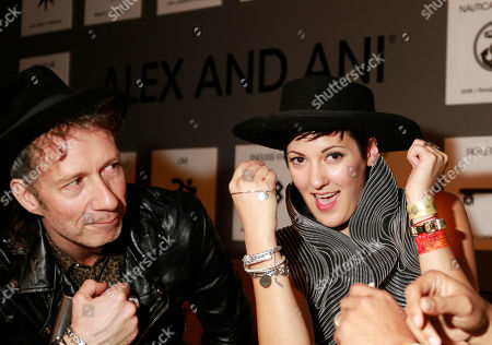 Vanessa Bley and Stuart Matthewman who their new Alex and Ani bracelets in the Universal Music Group SXSW 2015 Experience, in Austin, Texas