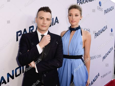 "Director Robert Luketic, left, and actress Amber Heard arrives on the red carpet at the US premiere of the feature film ""Paranoia"" at the DGA Theatre on in Los Angeles"