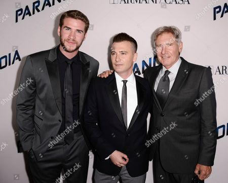 "Actor Liam Hemsworth, left, director Robert Luketic, center, and actor Harrison Ford arrive on the red carpet at the US premiere of the feature film ""Paranoia"" at the DGA Theatre on in Los Angeles"