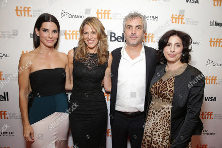 Sandra Bullock, Warner Bros.' Lynn Harris, Director/Writer/Producer Alfonso Cuaron and President of Worldwide Marketing and International Distribution, Warner Bros. Pictures Sue Kroll seen at Warner Bros. 'Gravity' Premiere at 2013 TIFF presented by Audi, on Sunday, Sep, 8, 2013 in Toronto