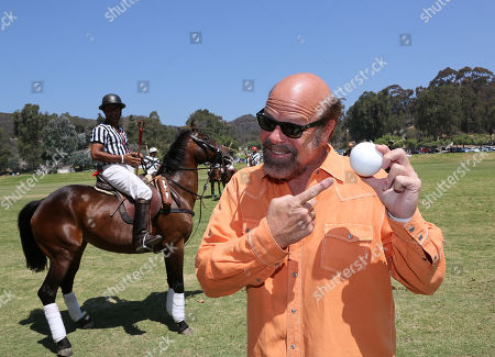Actor Rex Linn poses during the Will Rogers Dog Iron Polo Cup event at the Will Rogers State Historic Park polo field, in Pacific Palisades, Calif