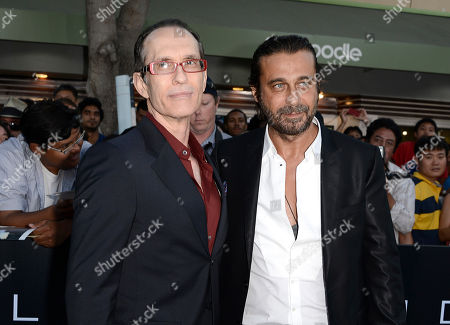 """Stock Picture of From left to right, director David Twohy and actor Jordi Molina arrive on the red carpet at the world premiere of the feature film """"Riddick"""" at the Regency Village Theatre on in Los Angeles"""