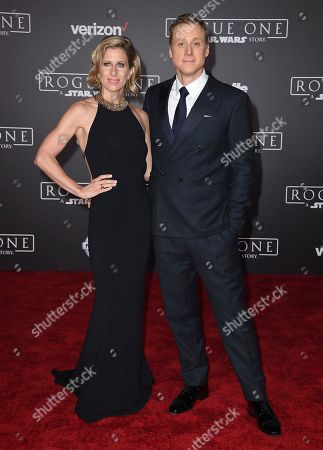 "Charissa Barton, left, and Alan Tudyk arrive at the world premiere of ""Rogue One: A Star Wars Story"" at the Pantages Theatre, in Los Angeles"