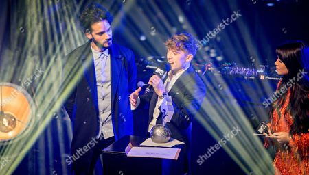 Dutch performer Lil' Kleine (C) receives the MTV European Music award for best Dutch act from Monica Geuze (R) and Kay Nambiar (L) during the EMA pre-party in Amsterdam, The Netherlands, 06 November 2017.