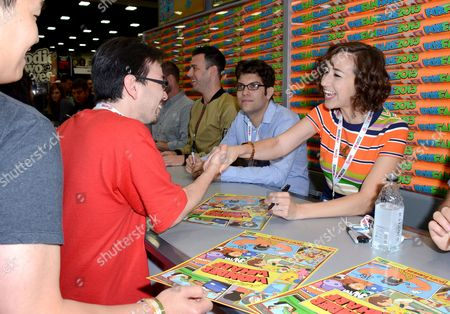 """Actor Kristen Schaal, right, attends the FOX """"Bob's Burgers"""" booth signing on Day 3 of Comic-Con International on in San Diego, Calif"""