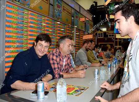 "From left, actors Eugene Mirman, Larry Murphy, executive producer Jim Dauterive, creator Loren Bouchard and actors John Roberts, Dan Mintz, Kristen Schaal and H. Jon Benjamin attend the FOX ""Bob's Burgers"" booth signing on Day 3 of Comic-Con International on in San Diego, Calif"