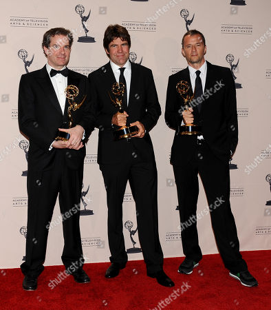 From left, Peter Bergen, Greg Barker, John Battsek poses in the press room at the 2013 Primetime Creative Arts Emmy Awards, on at Nokia Theatre L.A. Live, in Los Angeles, Calif