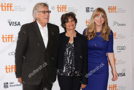 """From left, Ivan Reitman, Lianne Halfon, Helen Estabrook arrive at the premiere of """"Labor Day"""" on day 3 of the Toronto International Film Festival at the Ryerson Theatre, in Toronto"""