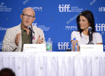 """Alex Gibney, left, and Betsy Andreu attend the press conference for """"The Armstrong Lie"""" on day 5 of the Toronto International Film Festival at the TIFF Bell Lightbox, in Toronto"""
