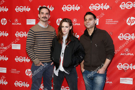 """Stock Photo of From left, Writer and director Peter Sattler, cast member Kristen Stewart, and cast member Peyman Moaadi, pose together at the premiere of the film """"Camp X-Ray"""" during the 2014 Sundance Film Festival,, in Park City, Utah"""