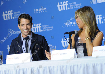 """Daniel Barnz, left, and Jennifer Aniston attend the press conference for """"Cake"""" on day 6 of the Toronto International Film Festival at the TIFF Bell Lightbox, in Toronto"""