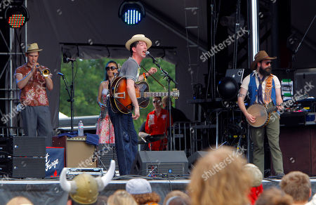 Andrew Heissler of Pokey LaFarge, center, performs at the Bonnaroo Music and Arts Festival on in Manchester, Tenn