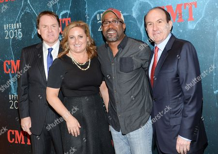 CMT President Brian Phillips, left, Viacom Kids and Family Group President Cyma Zarghami, singer Darius Rucker and Viacom President & CEO Philippe Dauman attend the 2015 CMT Upfront event at the TimesCenter, in New York
