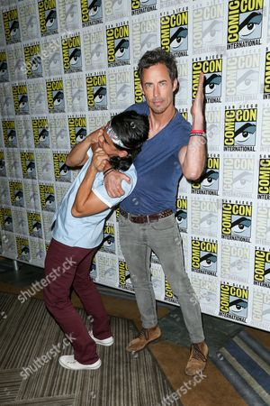 "Carlos Valdes, left, and Tom Cavanagh attend the ""Flash"" press line on day 3 of Comic-Con International, in San Diego"