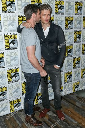 """Daniel Gillies, left, and Joseph Morgan attendthe """"The Originals"""" press line on day 2 of Comic-Con International, in San Diego"""