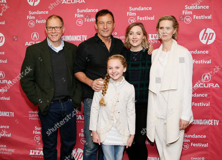 "Cast members, from left to right, David Warshofsky, Jason Isaacs, Avery Phillips, Saoirse Ronan, and Cynthia Nixon interact as they pose at the premiere of ""Stolkholm, Pennsylvania"" during the 2015 Sundance Film Festival, in Park City, Utah"