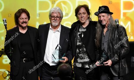 Left to right, Tom Johnston, Michael McDonald, John McFee and Pat Simmons of the band the Doobie Brothers pose together onstage after receiving the ASCAP Voice of Music Award at the 32nd Annual ASCAP Pop Music Awards at the Loews Hollywood Hotel, in Los Angeles