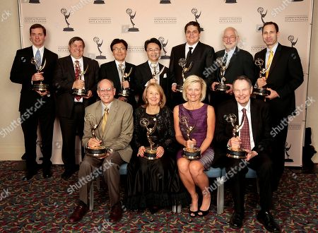 Stock Photo of HOLLYWOOD, CA - OCTOBER 24: The 2012 Enineering Awards recipients (Back Row L-R) Peter Postma, Gary Mandle, Fukaishi Akira, Oshima San, Mark Jaszberenyi, Stephen Lighthill, Matt Marenghi, (Front Row (L-R) Ray Feeney, Joan Vogelsang, Kim Snyder and Richard Green at the Academy of Television Arts & Sciences 64th Primetime Emmy Engineering Awards at the Loews Hollywood Hotel on in Hollywood, California