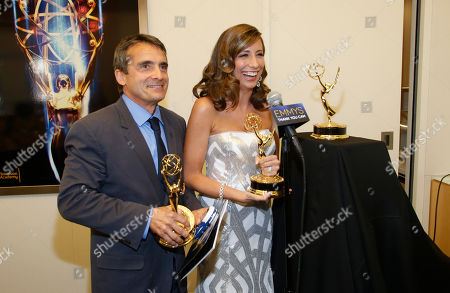 "Stephen Galloway and Brenda Brkusic are seen backstage with the award for arts and culture/history for ""The Hollywood Reporter in Focus: The Wolf of Wallstreet"" at the Television Academy's 66th Los Angeles Area Emmy Awards on at The Leonard H. Goldenson Theater in the NoHo Arts District in Los Angeles"