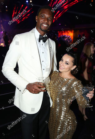 Chris Bosh, left, and Adrienne Williams Bosh attend the Governors Ball at the 66th Primetime Emmy Awards at the Nokia Theatre L.A. Live, in Los Angeles