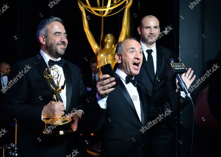 "Simon Blackwell, from left, Amando Ianucci, and Tony Roche participate in an interview backstage with the award for outstanding writing for a comedy series for ""Veep"" Election Night at the 67th Primetime Emmy Awards, at the Microsoft Theater in Los Angeles"