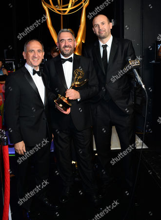 "Amando Ianucci, from left, Simon Blackwell, and Tony Roche pose backstage with the award for outstanding writing for a comedy series for ""Veep"" Election Night at the 67th Primetime Emmy Awards, at the Microsoft Theater in Los Angeles"