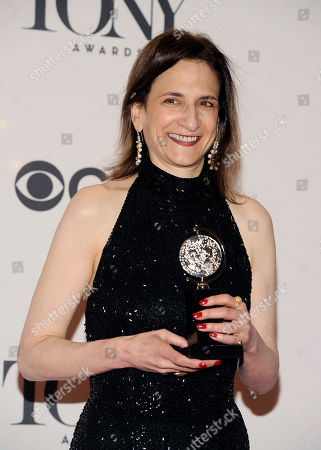 """Natasha Katz poses with her award for best lighting design of a play for """"The Glass Menagerie"""" in the press room at the 68th annual Tony Awards at Radio City Music Hall, in New York"""