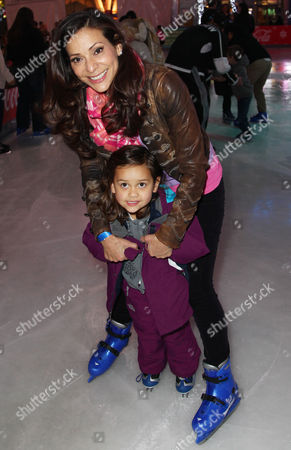 Actress Constance Marie, top, and her daughter, Luna Marie Katich, ice skate at AEG's Season of Giving celebrates Disney on Ice: Dare to Dream and Baby Buggy's Holiday Diaper Drive at L.A. LIVE, in Los Angeles