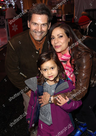 Actor D.W. Moffett, left, actress Constance Marie, right, and Luna Marie Katich pose together at AEG's Season of Giving celebrates Disney on Ice: Dare to Dream and Baby Buggy's Holiday Diaper Drive at L.A. LIVE, in Los Angeles